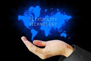 flexible technology hand holding world map